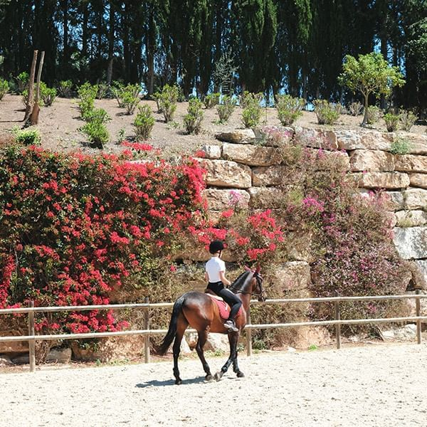 A lady riding  horse