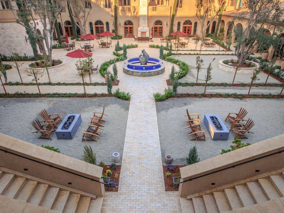 Allegretto Vineyard Resort Courtyard with fire pits and water fountain