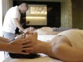 A lady getting a head Massage in the spa at Ana Hotels