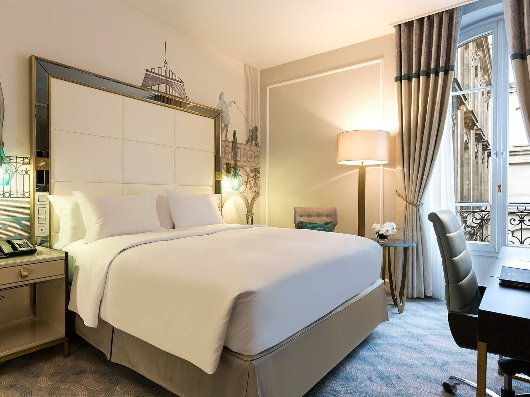 Bed & furniture in Deluxe Room at Hilton Paris Opera Hotel