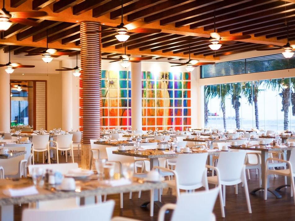 White dining tables in Miramar Restaurant in The Reef Coco Beach
