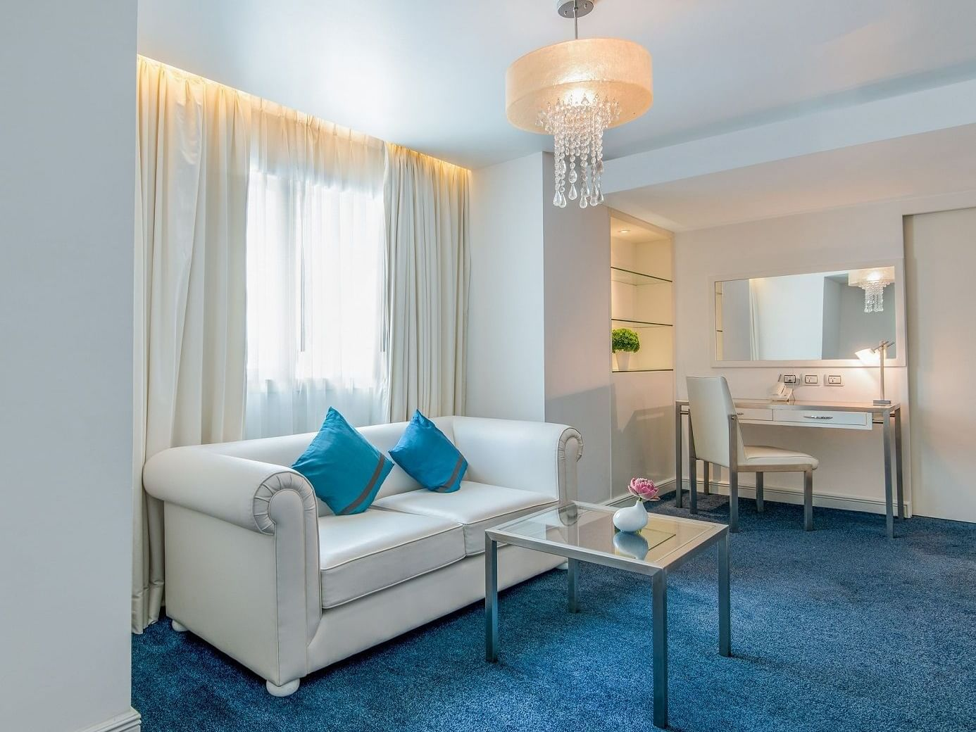 Room with sofa set ,glass table Gold Suite at Dream Bangkok