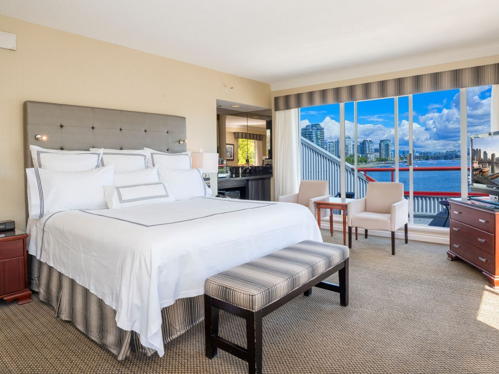 Boardwalk Suite bedroom with king bed at Granville Island Hotel