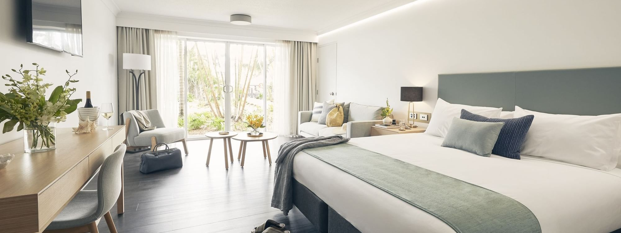 Superior Room with king sized bed at Daydream Island Resort
