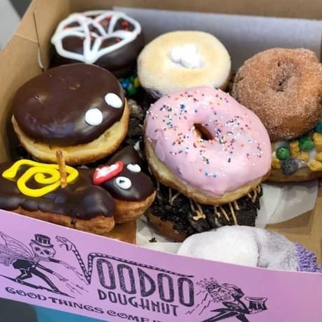 an assortment of donuts in a box