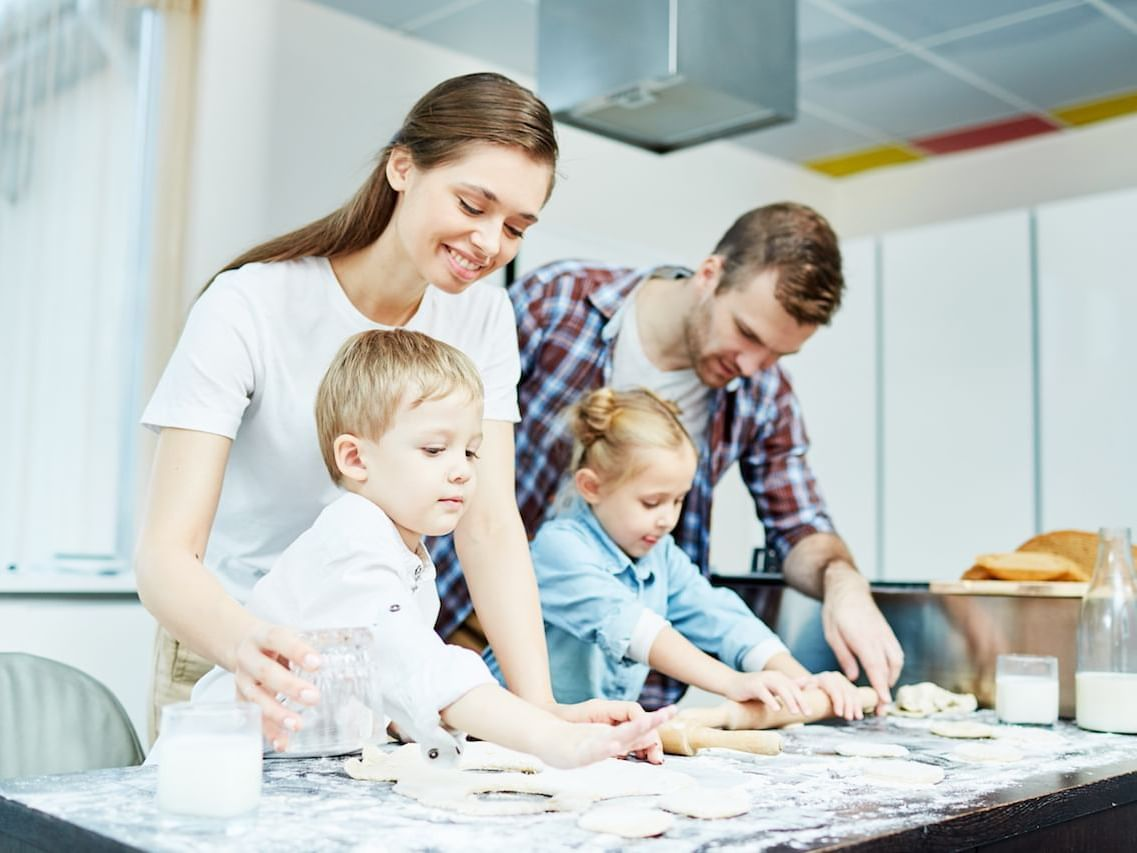 Family baking pastries together