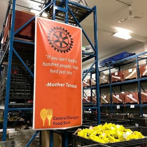 A banner hung at Central Okanagan Food Bank near Manteo Resort