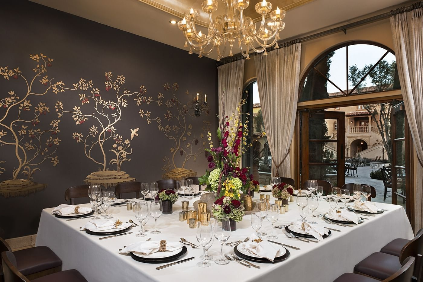 The Murano Private dining room prepared for a party of 14