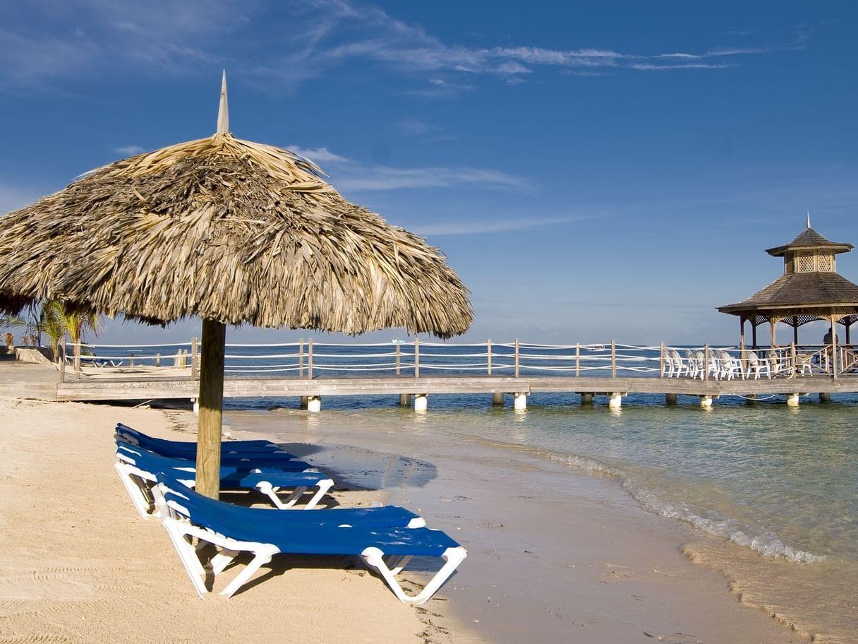 Straw Beach umbrella & sunbeds near Holiday Inn Montego Bay