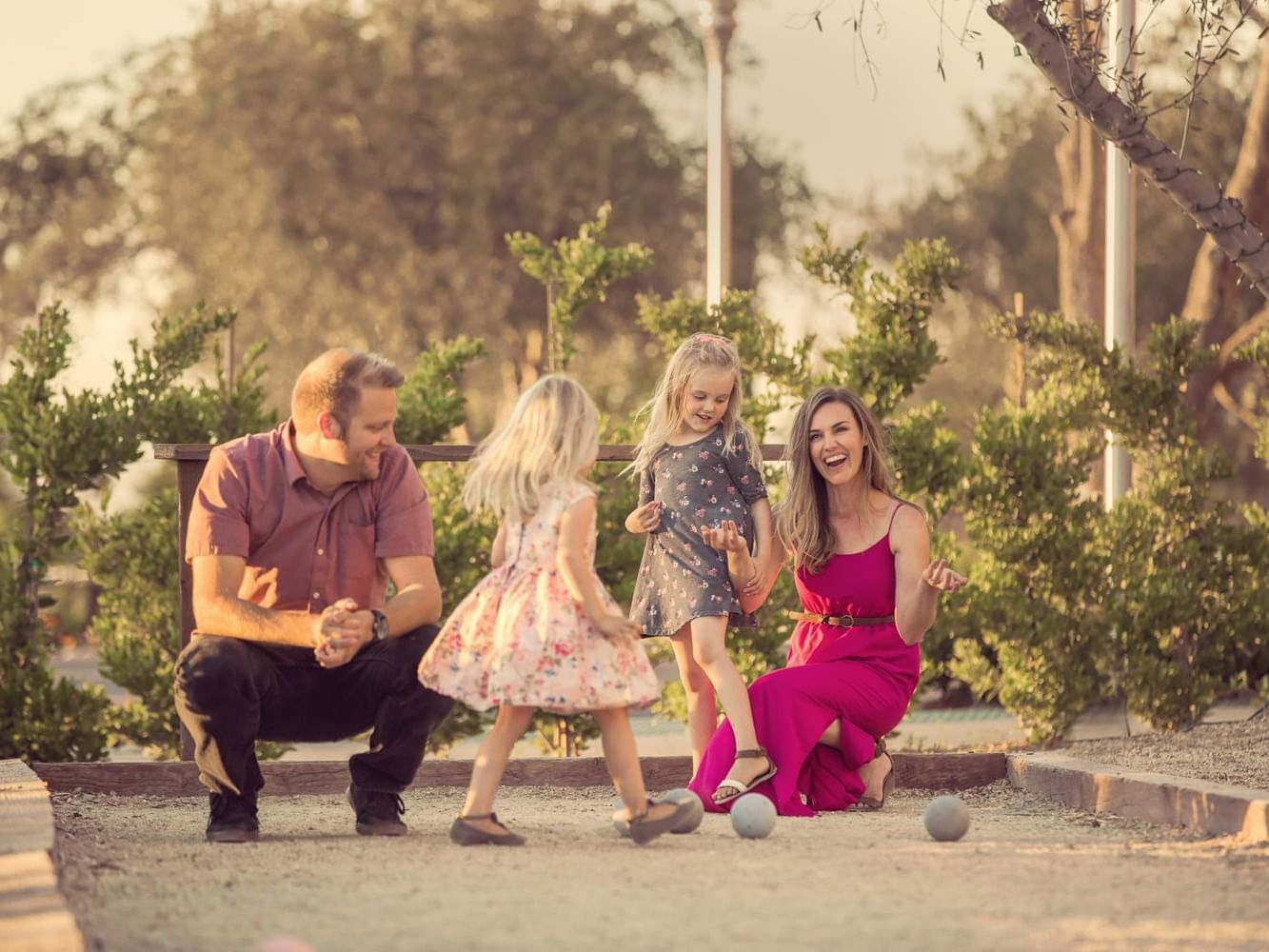 Family of four playing in garden