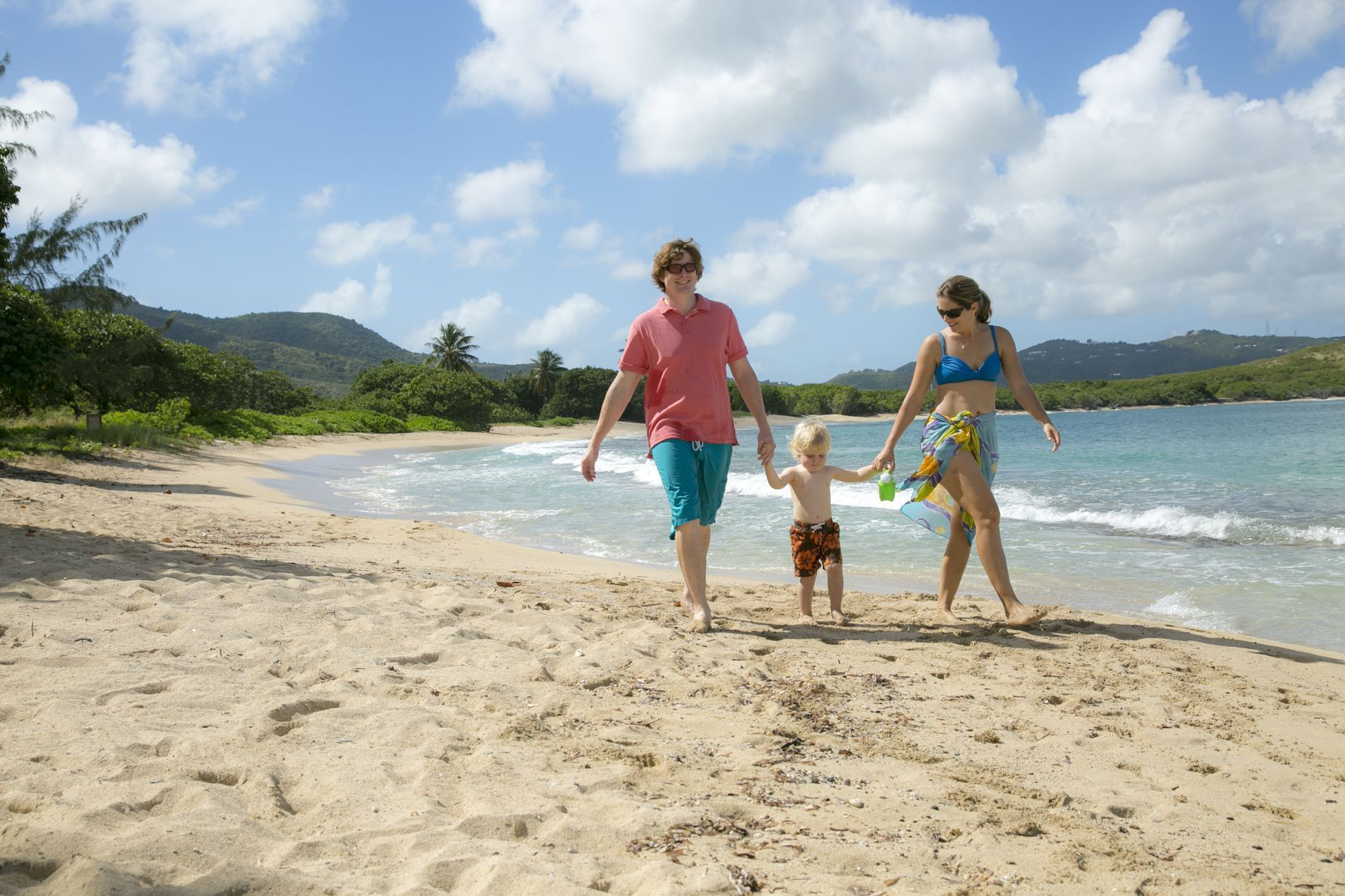 Family Strolling on beach
