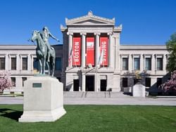a statue in front of the Museum of Fine Arts