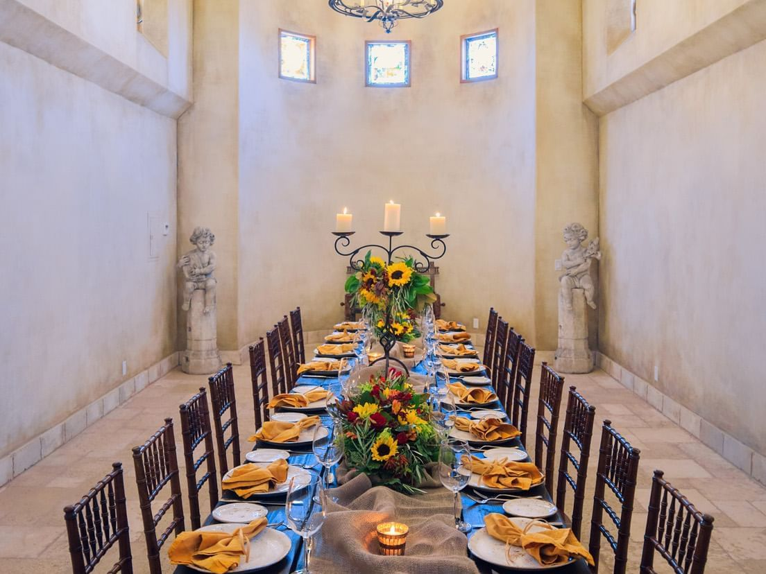 Dinner table set up with flowers in Allegretto Abbey