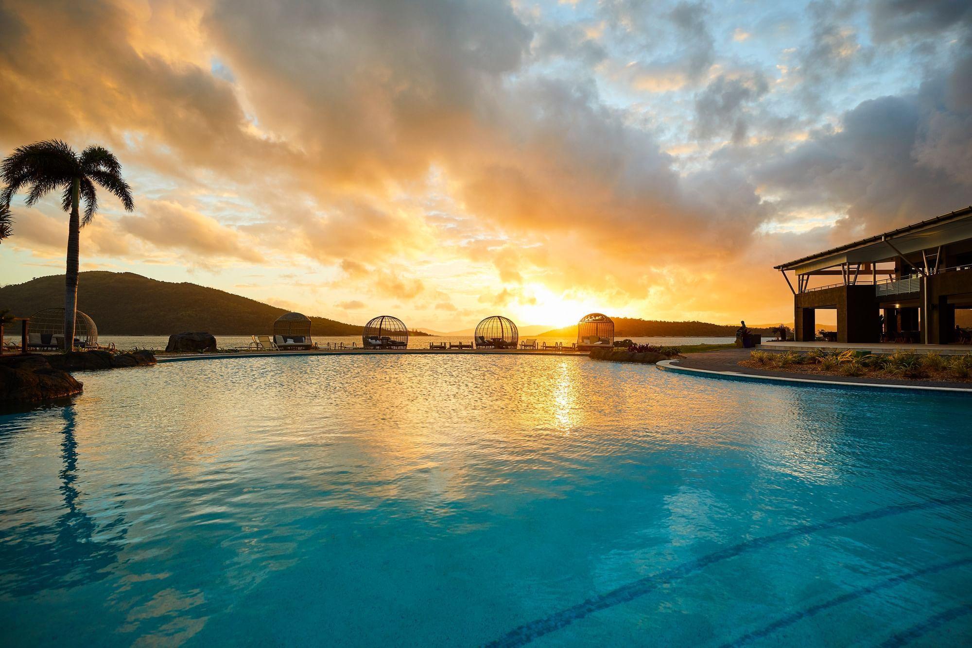 Swimming pool at sunset at Daydream Island Resort