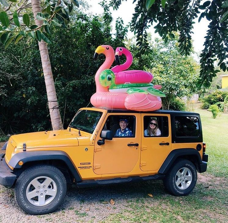 Family on a cruise in a Jeep near El Blok Hotel