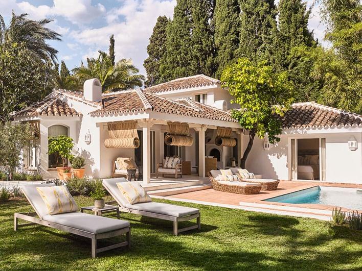 Exterior pool view with villa at Marbella Club