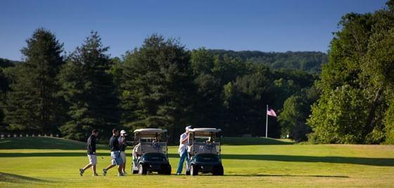 Gentlemen playing golf at Pomperaug Golf Club