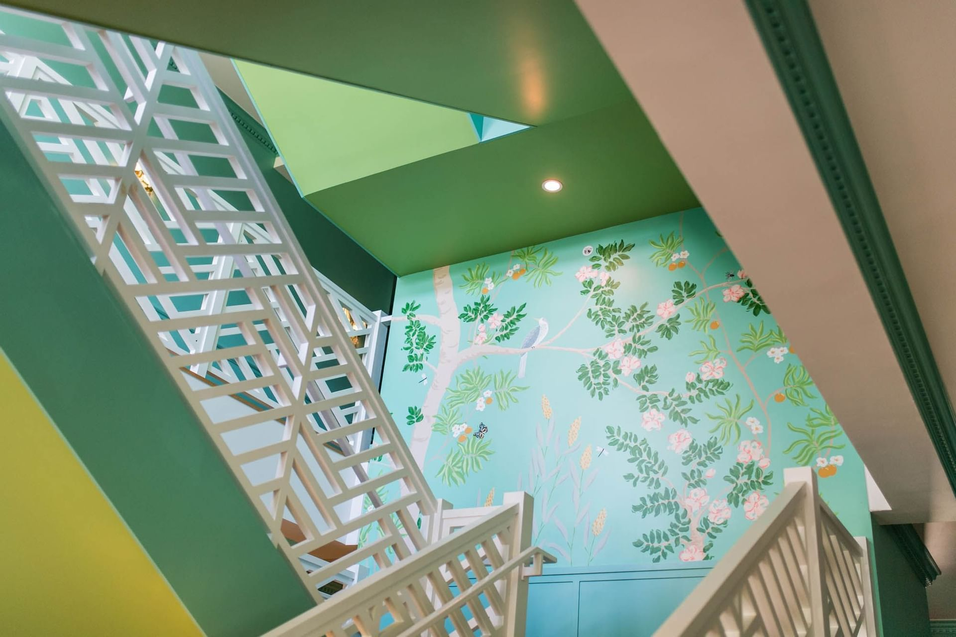 green stairwell with tree painting