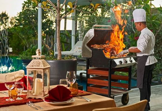Chef using the BBQ gril in Villa BBQ at The Danna Langkawi