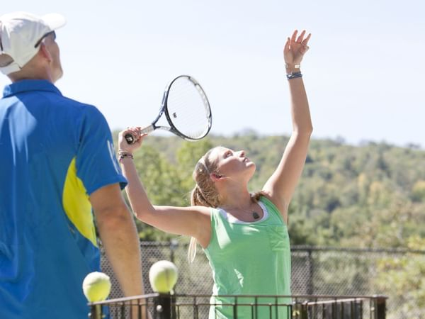 Two people playing tennis at Topnotch Stowe Resort