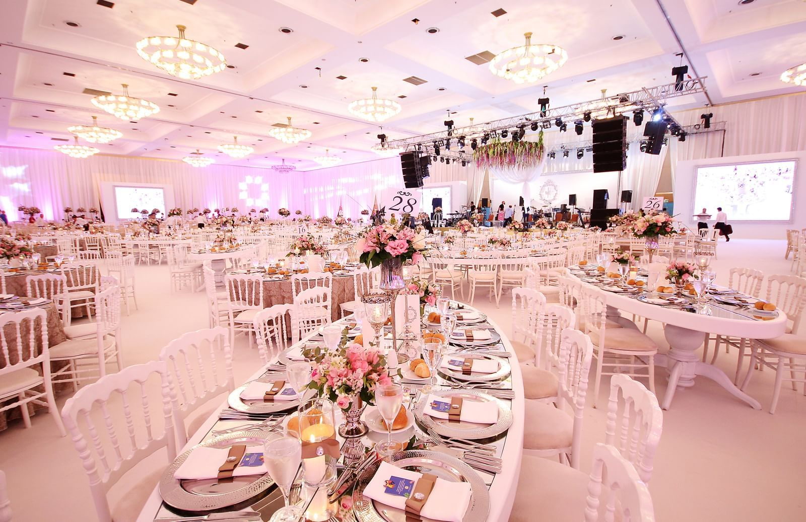 Wedding hall with oval shape tables at Wow Hotels Group