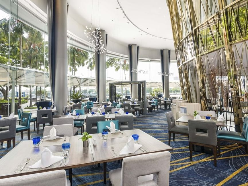 Elegant dining area of River Barge Restaurant at Chatrium Hotel Riverside Bangkok