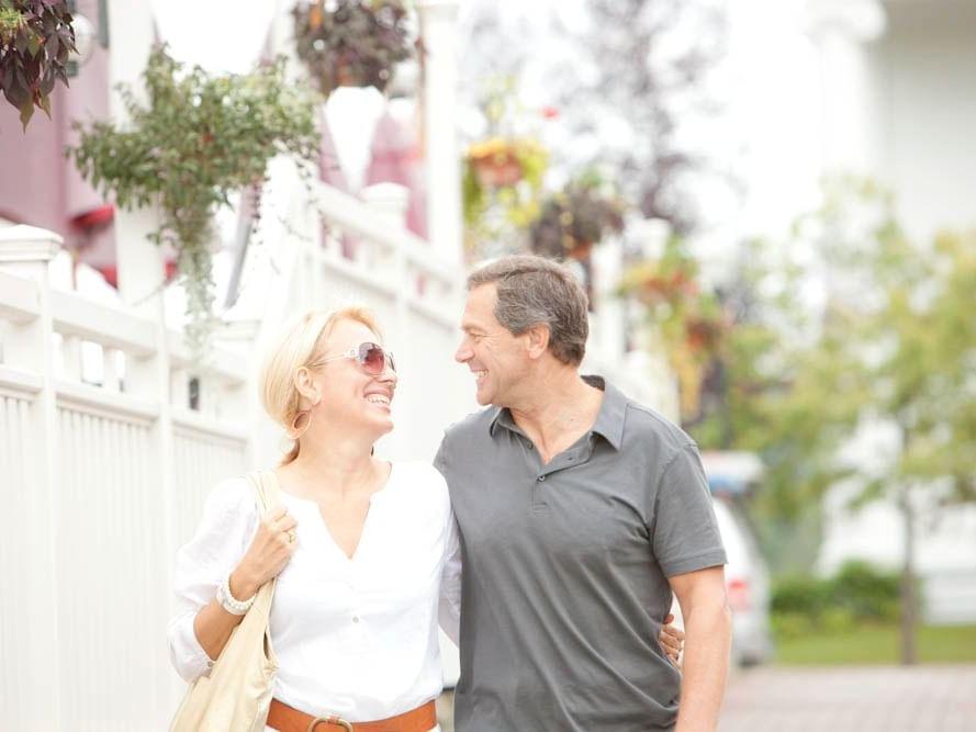 A couple walking down Stowe Streets near Topnotch Stowe Resort