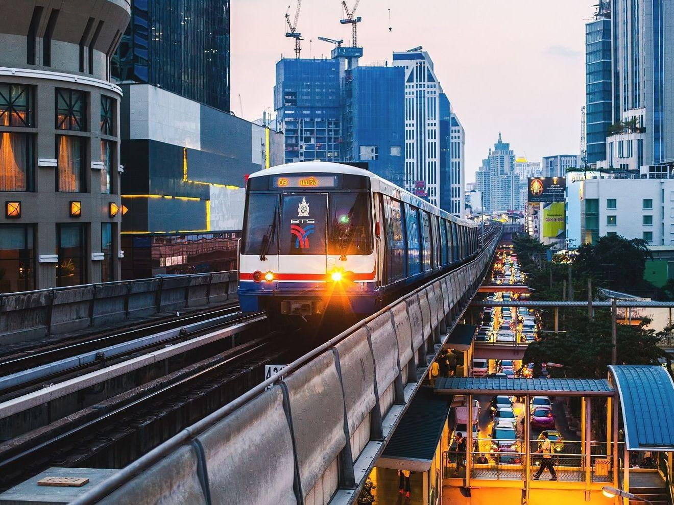 A train goes over a bridge neat dream Thailand  Bangkok