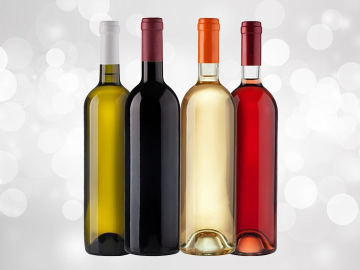 An assortment of wine bottles on a silver background