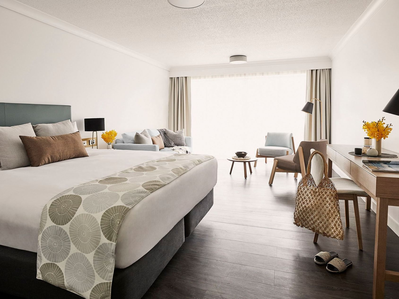 Comfy bed and table in Family room at Daydream Island Resort