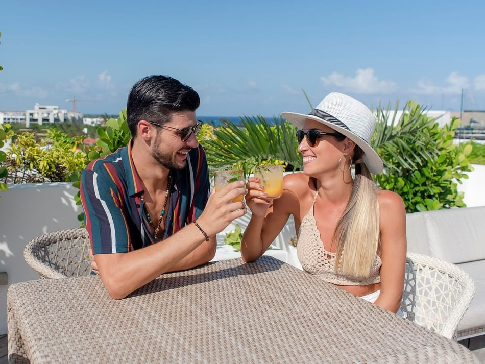 A couple having a drink in Roof 28 restaurant at The Reef 28