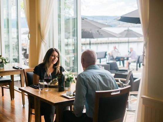A couple dining at the Lakeside Dining Room in Manteo Resort