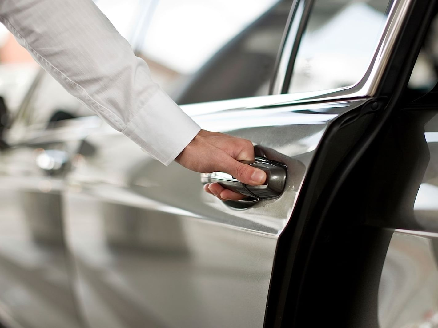 Close-up of hand holding car door handle at Dream Hollywood LA