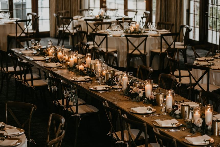 large community table with flower centerpieces