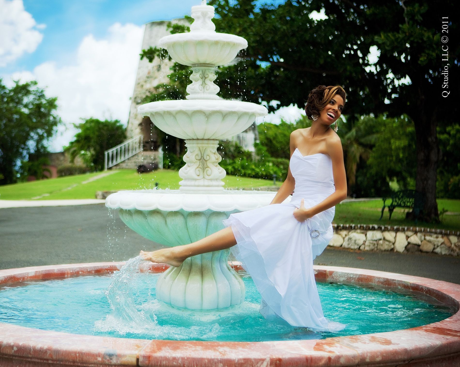 Bride splashing in fountain