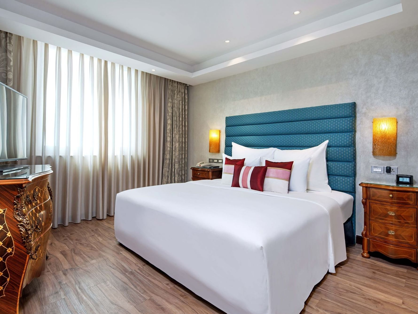 spacious hotel room with king beds