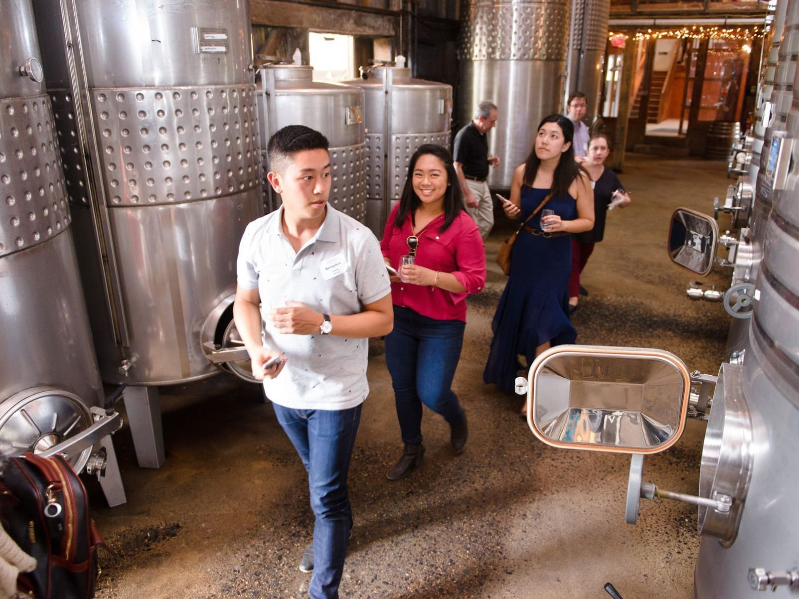 group of people touring a winery