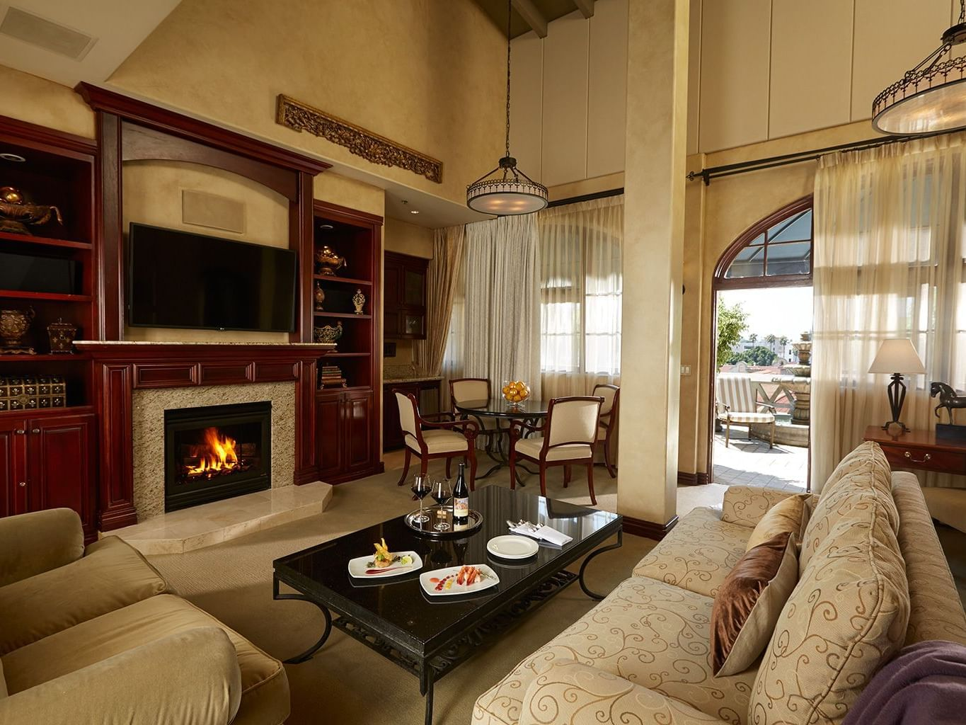 large living room with television over fireplace and door to exterior