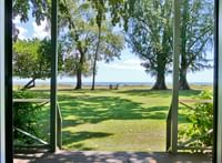 View of Waimea Plantation Cottage grounds with ocean views