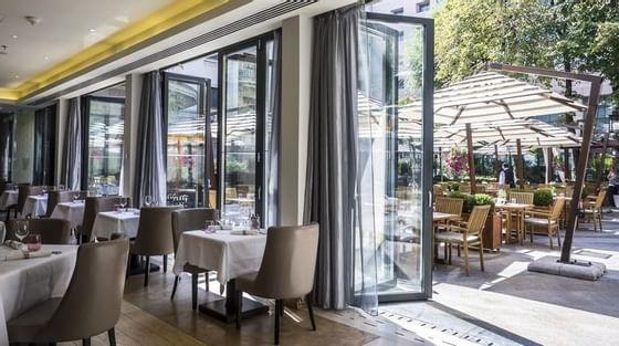 Dining area in a Restaurant at Athénée Palace Hilton Bucharest