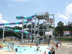 groups of people playing in a pool and water slide