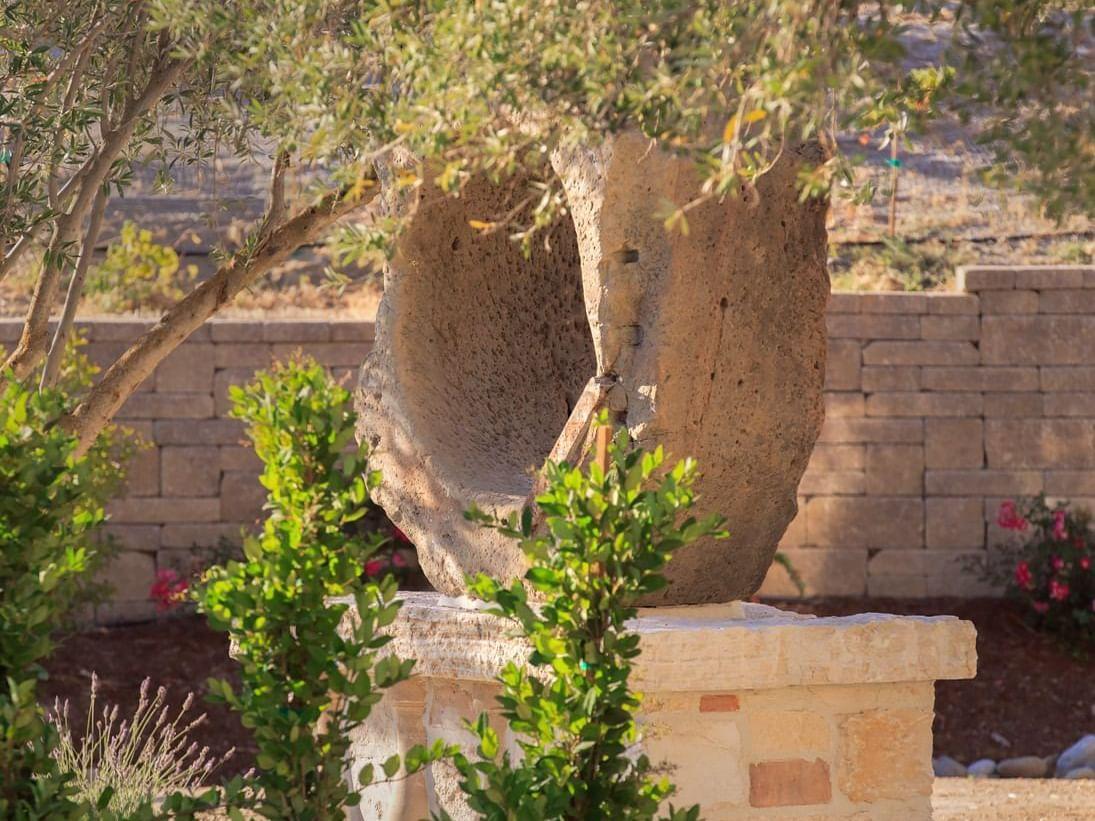 Stone sculpture in garden at Allegretto Vineyard Resort