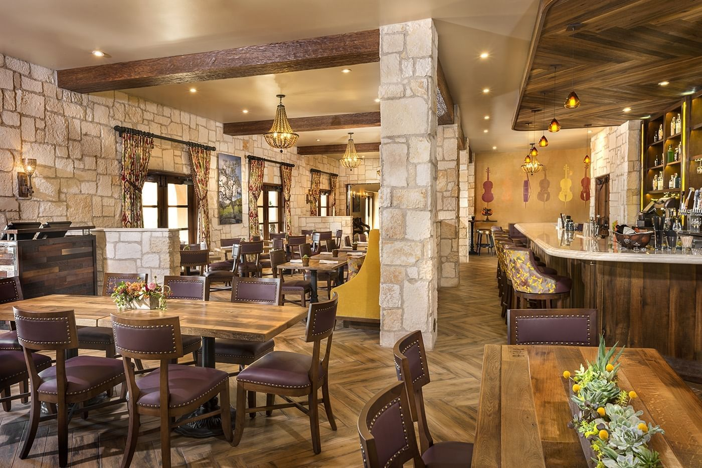 Looking through the Cello Restaurant with stone walls and wood b