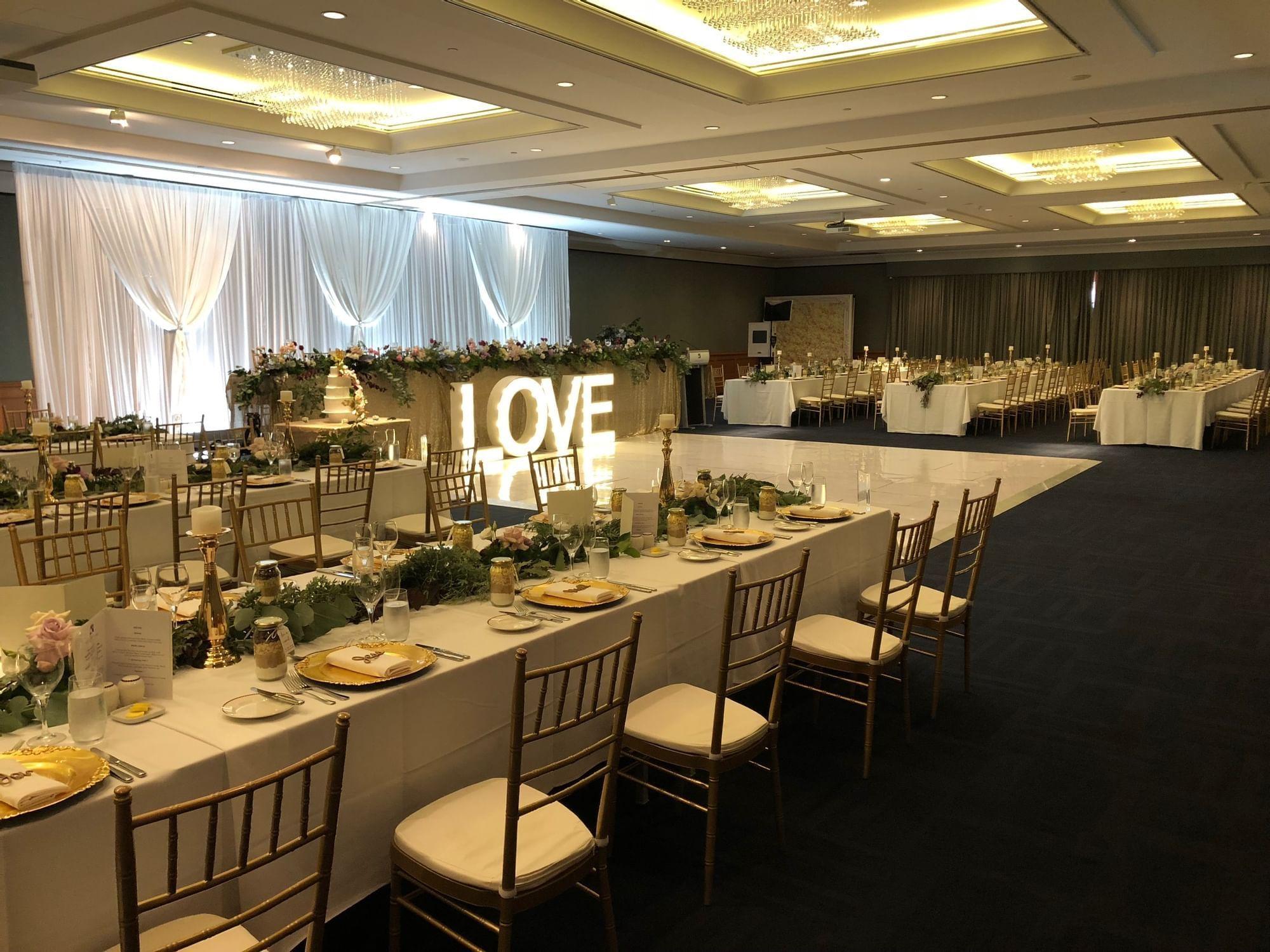 Ballroom wedding reception with love sign at Duxton Hotel Perth