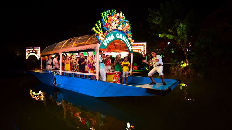 A decorated boat event near The Reef Resorts