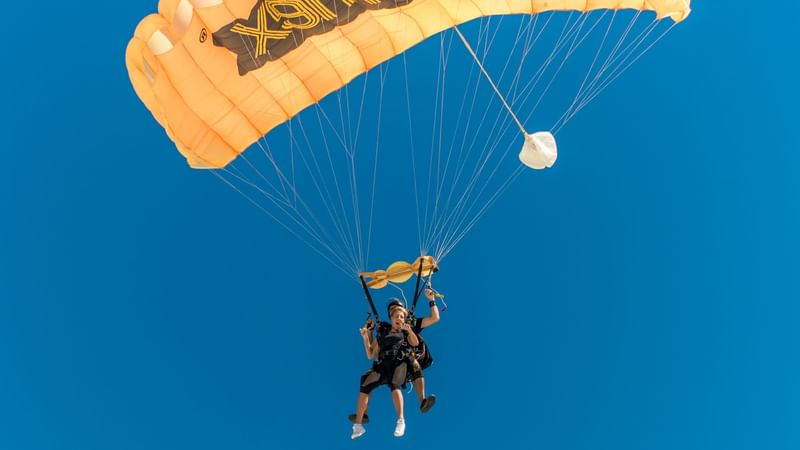 Guests skydiving at The Reef Resorts