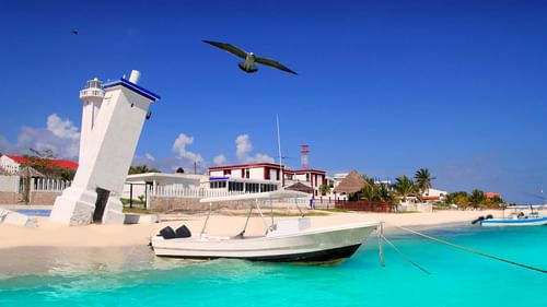 Puerto morelos with boat near The Reef Resorts