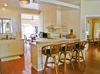 cottage kitchen with bar seating at Waimea Plantation Cottages
