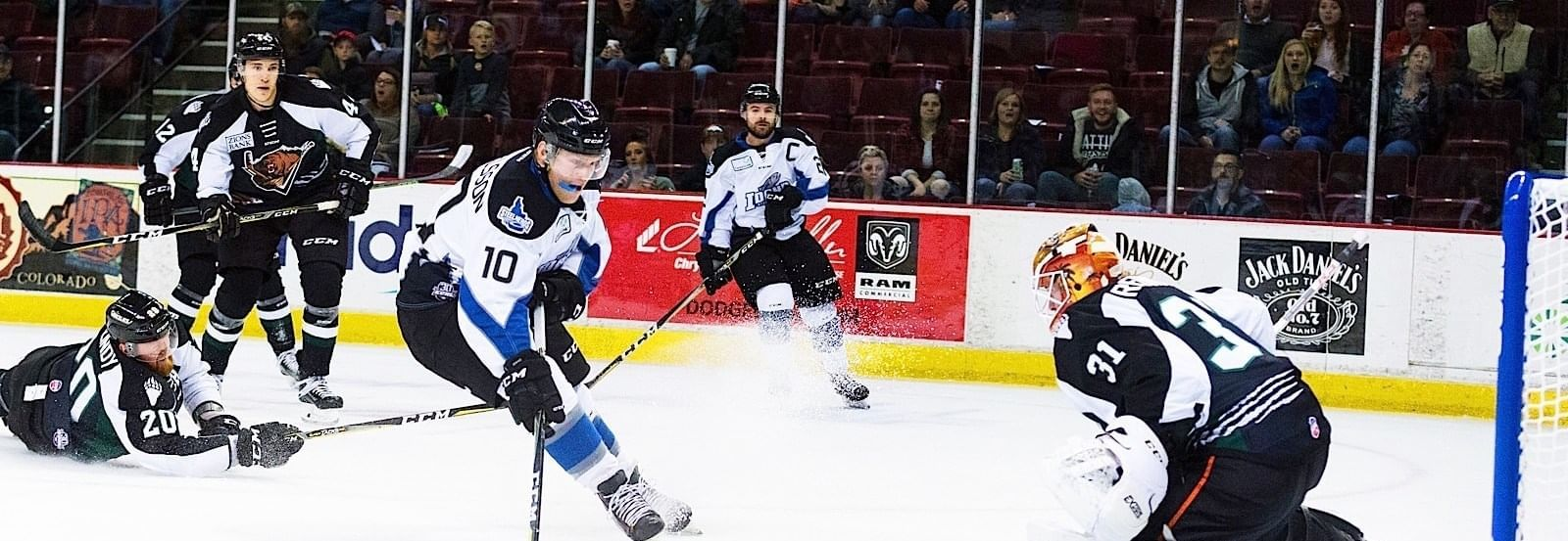 Ice hockey players going for a goal