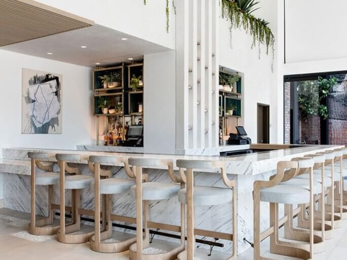 Fully white theme chair and  Sunrise Cafe at Dream Hollywood